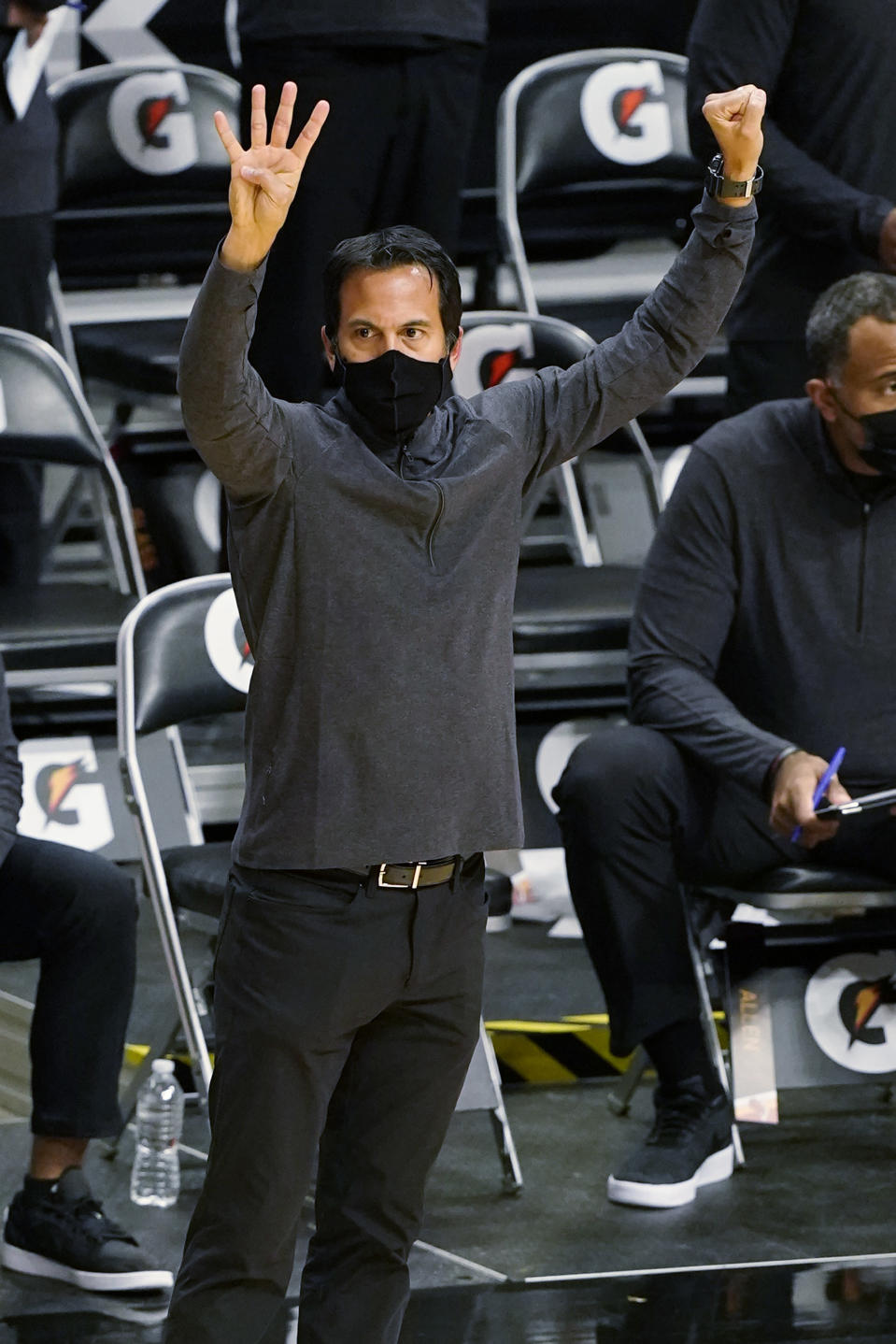 Miami Heat head coach Erik Spoelstra gestures during the first half of an NBA basketball game against the Detroit Pistons, Monday, Jan. 18, 2021, in Miami. (AP Photo/Marta Lavandier)