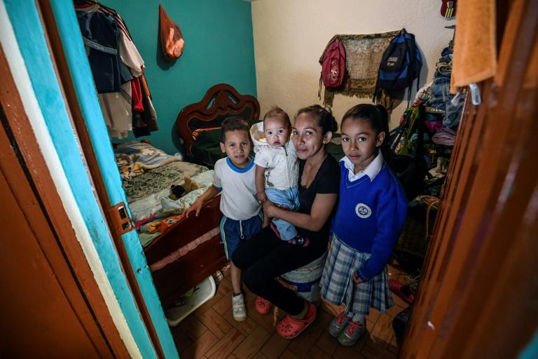 Venezuelan Yisela Palencia poses with her children in Bogota, Colombia