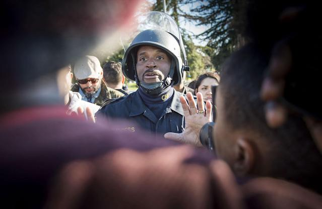 <p>CHP officer Matthew Burgess, pleads with Black Lives Matter supporters to move off Interstate 5 after a they converged on the interstate and closed it down during rush hour traffic in Sacramento in protest of the death of unarmed Stephon Clark in South Sacramento on Thursday, March 22, 2018. (Photo: Hector Amezcua/TNS via ZUMA Wire) </p>