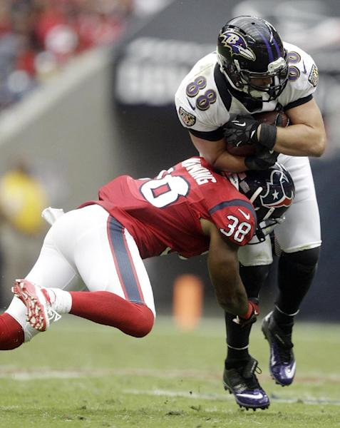 Houston Texans free safety Danieal Manning (38) tackles Baltimore Ravens tight end Dennis Pitta (88) during the third quarter of an NFL football game on Sunday, Oct. 21, 2012, in Houston. (AP Photo/Patric Schneider)