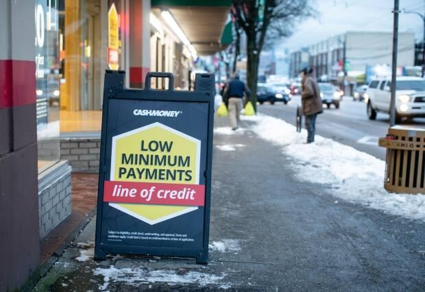 Payday lenders promote lines of credit as well as instalment loans, which critics say are so expensive they can trap borrowers in a cycle of debt. This photo, taken in January 2020, shows a Money Mart location in Vancouver.  (Maggie MacPherson/CBC - image credit)