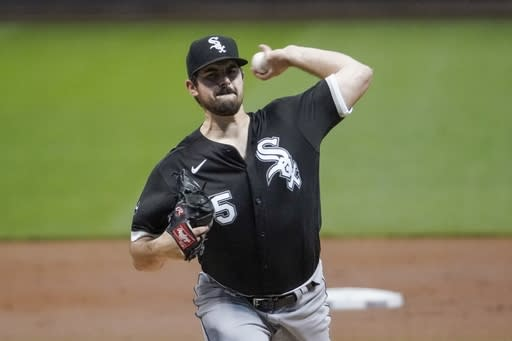 Chicago White Sox starting pitcher Carlos Rodon throws during the first inning of a baseball game Monday, Aug. 3, 2020, in Milwaukee. (AP Photo/Morry Gash)