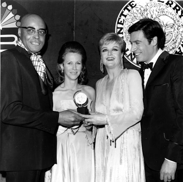 File-This April 20, 1969 file photo shows Broadway stars, from left, James Earl Jones, Julie Harris, Angela Lansbury and Jerry Orbach pose on stage after receiving Tony awards at the 23rd Annual Tony Awards ceremony at New York's Mark Hellinger Theatre. Harris, who won an unprecedented five Tony Awards for best actress, has died. She was 87. Actress and family friend Francesca James says Harris died Saturday Aug. 24, 2013 at her home in West Chatham, Mass. She had previously suffered two strokes. (AP Photo/File)