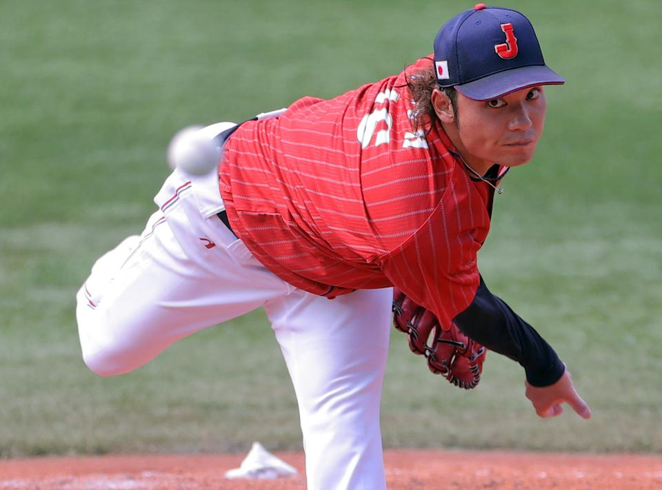 <p>Japan's relief pitcher Hiromi Itoh hurls the ball during the seventh inning of the Tokyo 2020 Olympic Games baseball opening round group A game between Japan and Mexico at Yokohama Baseball Stadium in Yokohama, Japan, on July 31, 2021. (Photo by KAZUHIRO FUJIHARA / AFP) (Photo by KAZUHIRO FUJIHARA/AFP via Getty Images)</p>