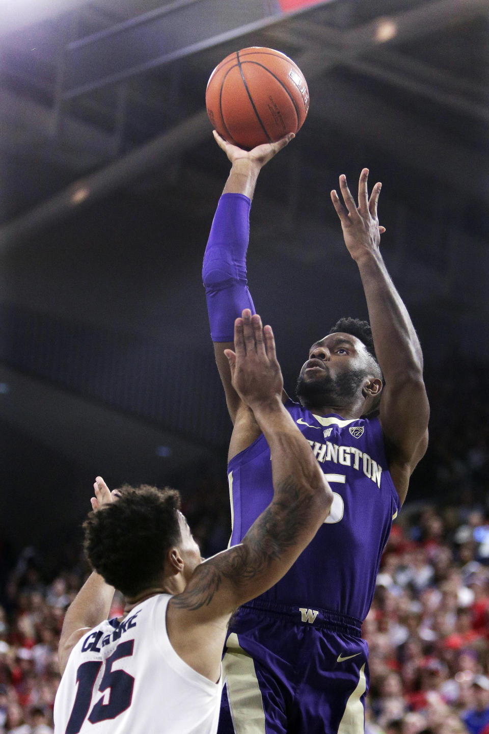 Washington guard Jaylen Nowell, right, shoots while defended by Gonzaga forward Brandon Clarke (15) during the first half of an NCAA college basketball game in Spokane, Wash., Wednesday, Dec. 5, 2018. (AP Photo/Young Kwak)