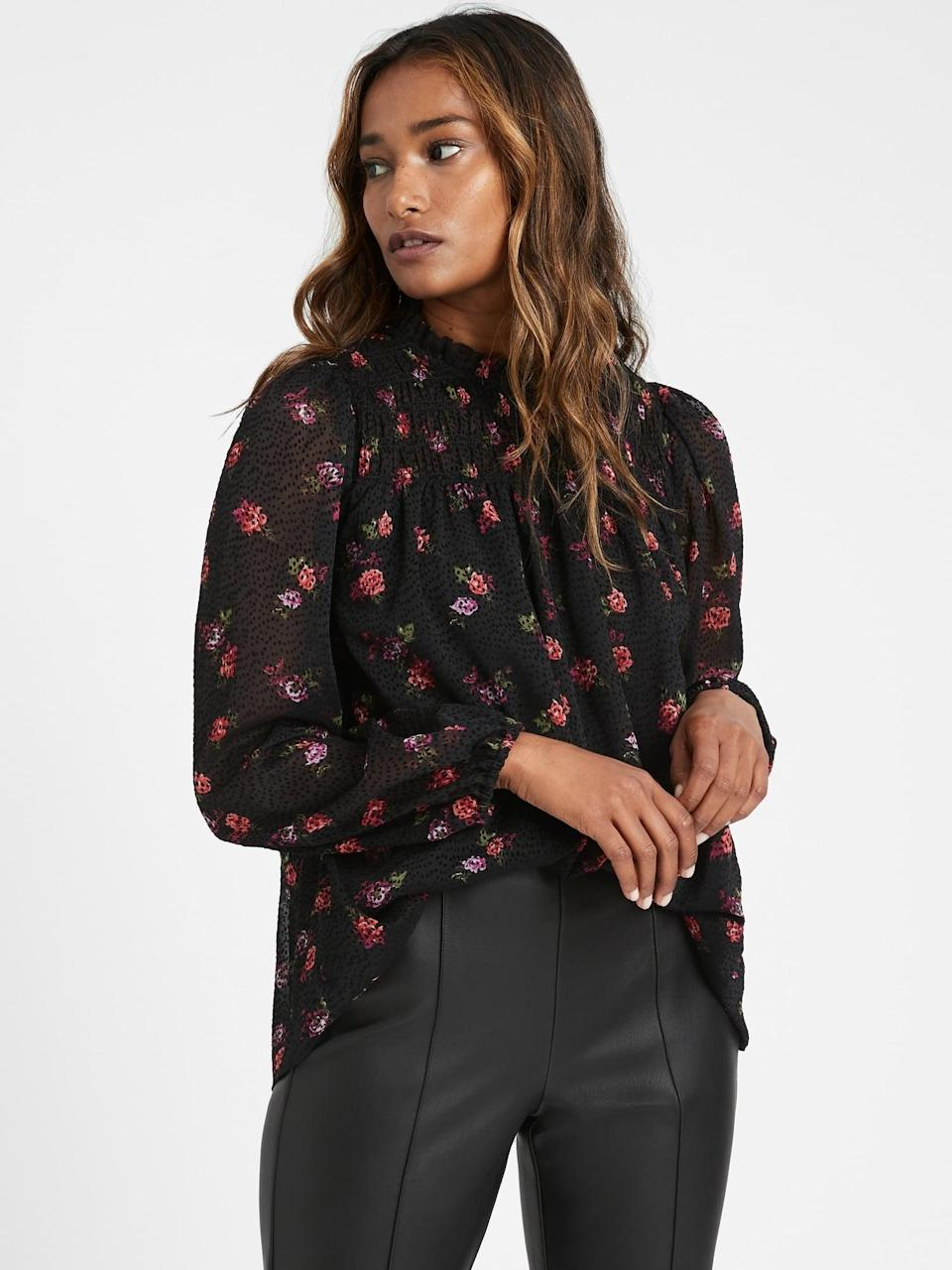 <p>This <span>Velvet Dot Smocked Ruffle-Collar Top</span> ($59, originally $85) looks great with jeans.</p>