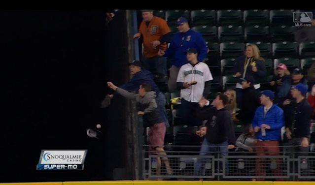 A Mariners fan lost his cap and a home run ball on this attempt. (MLB.com Screen shot)