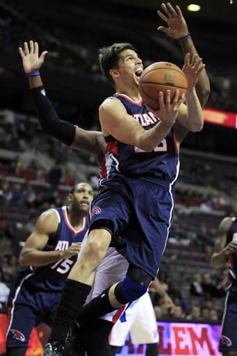 Atlanta Hawks guard Kyle Korver makes a layup during the second quarter of an NBA preseason basketball game against the Detroit Pistons at the Palace of Auburn Hills, Mich., Friday, Oct. 26, 2012. (AP Photo/Carlos Osorio)