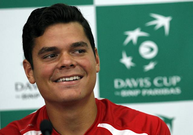 Canada Davis Cup team player Milos Raonic smiles during a press conference in Belgrade, Serbia, Wednesday, Sept. 11, 2013. Canada will play Serbia in the Davis Cup semifinal starting on Sept. 13 in Belgrade. (AP Photo/Darko Vojinovic)