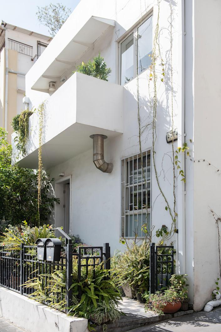 A look at the building's Bauhaus façade—a bright splash of geometric white on an unassuming side street, a skip away from Tel Aviv's famed Carmel Market.
