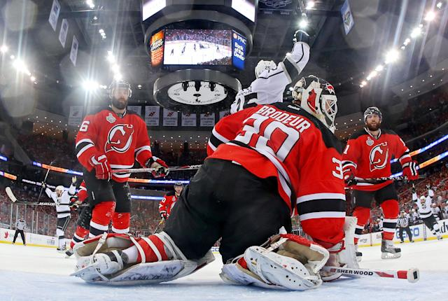 NEWARK, NJ - JUNE 02: Jeff Carter #77 of the Los Angeles Kings (not pictured) shoots the game winning goal in overtime passed Martin Brodeur #30 of the New Jersey Devils as Andy Greene #6, Dustin Penner #25 and Stephen Gionta #11 look on during Game Two of the 2012 NHL Stanley Cup Final at the Prudential Center on June 2, 2012 in Newark, New Jersey. (Photo by Bruce Bennett/Getty Images)