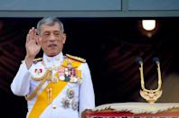 Thailand's newly crowned King Maha Vajiralongkorn is seen at the balcony of Suddhaisavarya Prasad Hall at the Grand Palace where he grants a public audience to receive the good wishes of the people in Bangkok, Thailand May 6, 2019.REUTERS/Soe Zeya Tun