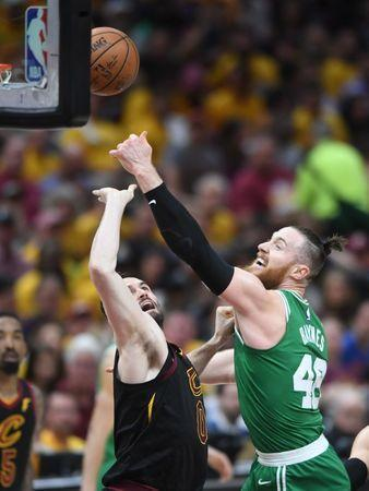 May 21, 2018; Cleveland, OH, USA; Cleveland Cavaliers center Kevin Love (0) and Boston Celtics center Aron Baynes (46) reach for a rebound during the second quarter in game four of the Eastern conference finals of the 2018 NBA Playoffs at Quicken Loans Arena. Mandatory Credit: Ken Blaze-USA TODAY Sports