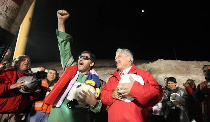 Luis Urzúa, the leader of the trapped miners, celebrating with Chilean President Sebastián Piñera