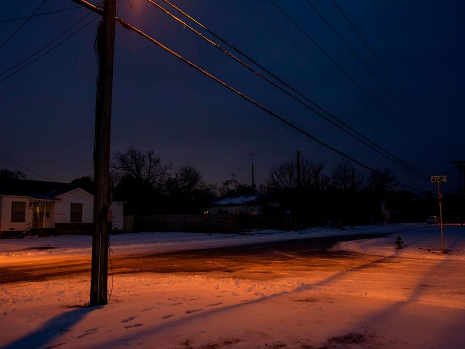 Snow covers the ground in Waco, Texas, on February 17, in front of homes with no power. Source: Getty