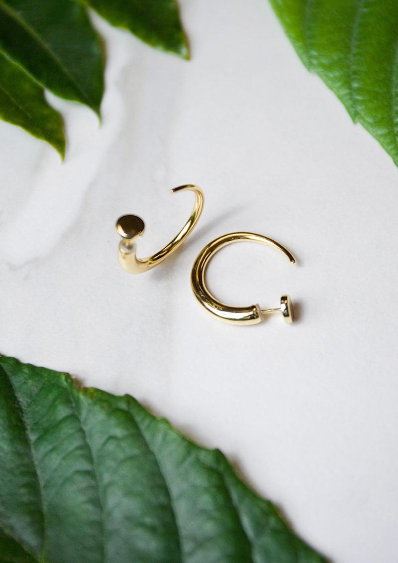 "These hoops are horn-inspired, and can be worn either backwards or forwards. Plus, <a href=""https://julessmithdesigns.com/collections/earrings/products/yari-hoops"" target=""_blank"">they're plated in 14k gold</a>, so they're good for sensitive earrings wearers."