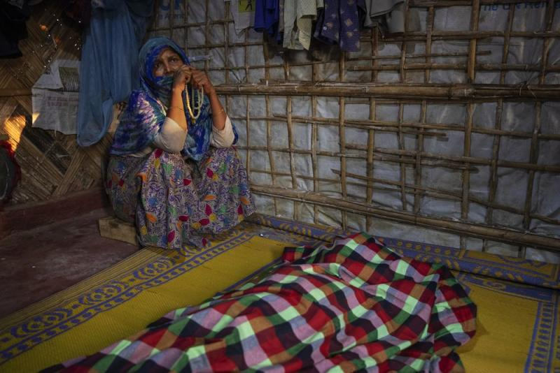 A woman grieves for Fatema Begum, 60, in the hut of the deceased. | James Nachtwey for TIME