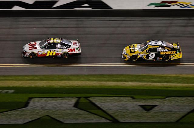 DAYTONA BEACH, FL - FEBRUARY 27: Greg Biffle, driver of the #16 3M Ford, leads Marcos Ambrose, driver of the #9 Stanley Ford, during the NASCAR Sprint Cup Series Daytona 500 at Daytona International Speedway on February 27, 2012 in Daytona Beach, Florida. (Photo by Streeter Lecka/Getty Images)
