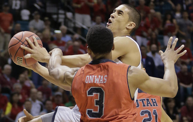 Arizona's Nick Johnson is fouled while shooting by Utah's Princeton Onwas (3) during the first half of an NCAA college basketball game in the quarterfinals of the Pac-12 Conference tournament, Thursday, March 13, 2014, in Las Vegas. (AP Photo/Julie Jacobson)