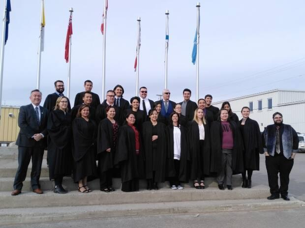 Students and staff with the Nunavut Law program pose for a photo in downtown Iqaluit in 2017, the year this program was formally launched. For the first time in more than 15 years, Nunavut has a group of homegrown lawyers. (Nunavut Law Program-Benjamin Ralston/The Canadian Press - image credit)