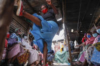 """Group leader Jane Waithageni Kimaru, 60, shows women how to fight off a potential rapist and escape, during a Taekwondo self-defense class for women in the Korogocho slum of Nairobi, Kenya, Thursday, Sept. 16, 2021. In Korogocho, which means """"crowded shoulder to shoulder"""" in Swahili, the women meet every week to train in skills they hope can help them fight back if they are sexually assaulted. (AP Photo/Brian Inganga)"""