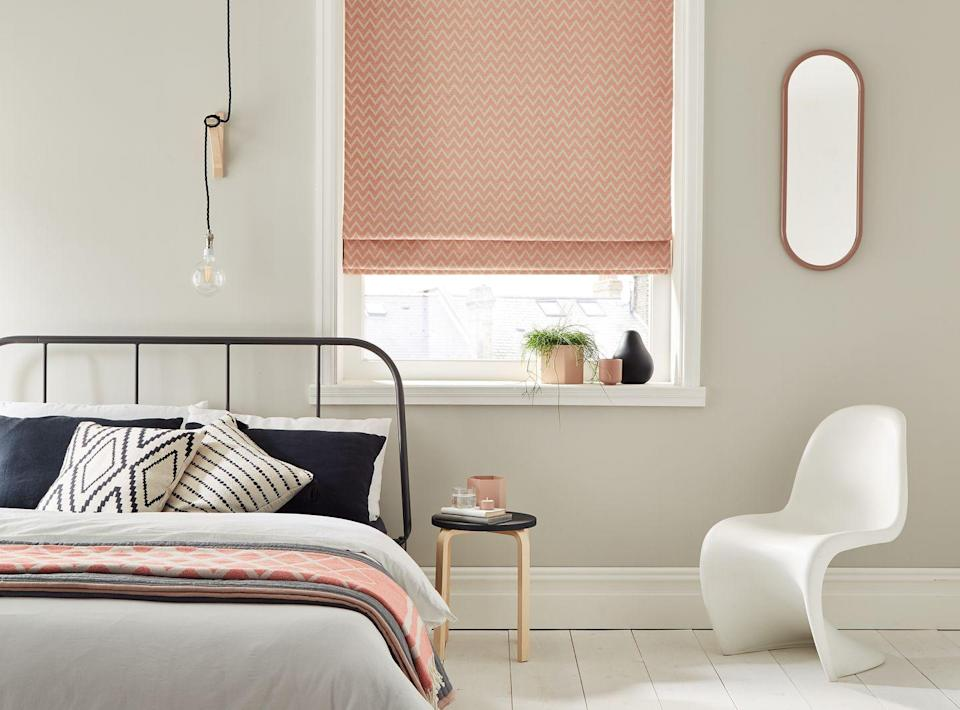 """<p>Focus on your bedroom's <a href=""""https://www.housebeautiful.com/uk/decorate/windows/a37062849/george-clarke-window-treatments-advice/"""" rel=""""nofollow noopener"""" target=""""_blank"""" data-ylk=""""slk:window treatment"""" class=""""link rapid-noclick-resp"""">window treatment</a> and brighten up your space with pink roller blinds. Whether you want patterned or plain, there's a style for every window. Muted grey walls work perfectly here to elevate the pink and black accessories.<br></p><p>• Roman blind from <a href=""""https://www.thomas-sanderson.co.uk/window-blinds/roman-blinds/"""" rel=""""nofollow noopener"""" target=""""_blank"""" data-ylk=""""slk:Thomas Sanderson"""" class=""""link rapid-noclick-resp"""">Thomas Sanderson</a> </p>"""