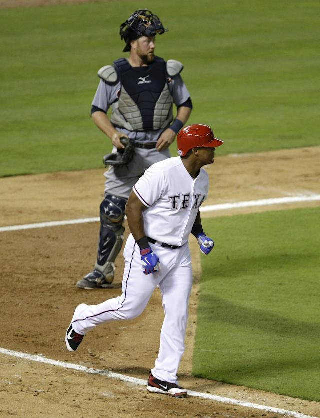 Texas Rangers' Adrian Beltre heads to first as he looks at Detroit Tigers' Anibal Sanchez on the mound after being hit by a pitch from Sanchez in the fifth inning of a baseball game, Wednesday, June 25, 2014, in Arlington, Texas. Tigers catcher Bryan Holaday is at rear. (AP Photo/Tony Gutierrez)