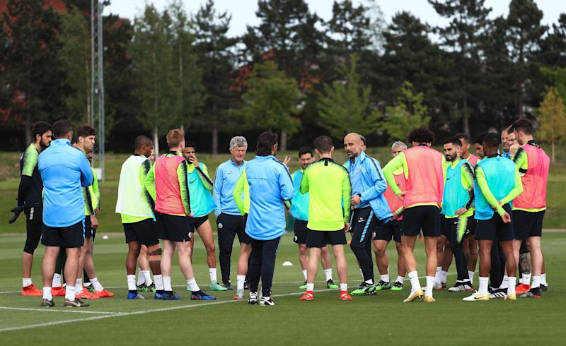 MANCHESTER, ENGLAND - MAY 16: Pep Guardiola, manager of Manchester City speaks to his players during the training session at Manchester City Football Academy on May 16, 2019 in Manchester, England. (Photo by Matt McNulty - Manchester City/Man City via Getty Images)