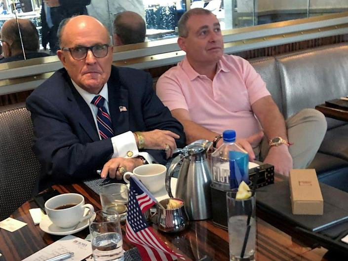 Mr Trump's personal lawyer Rudy Giuliani has coffee with Ukrainian-American businessman Lev Parnas: Reuters