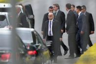 Brazil's President Bolsonaro is escorted by security guards upon arrival at Alvorada Palace in Brasilia