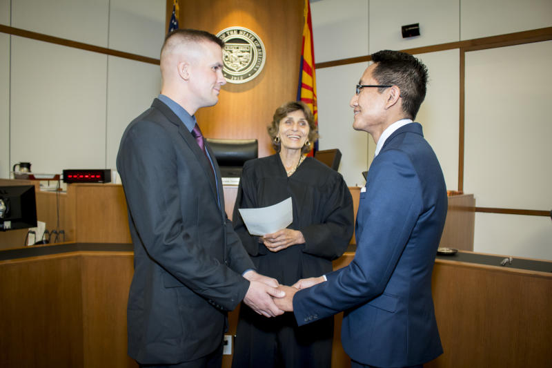 Davide Beaty-Nez (left) and Larrison Beaty-Nez (right) married at Tucson City Hall. (Celesteal Photography)