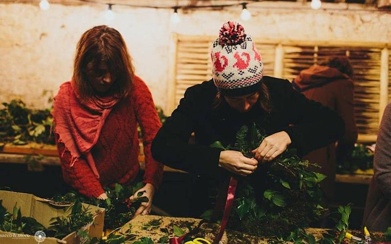 Whether by candlelight or in a working Sussex wood yard, here's where to make your own wreath this year - sacco photography