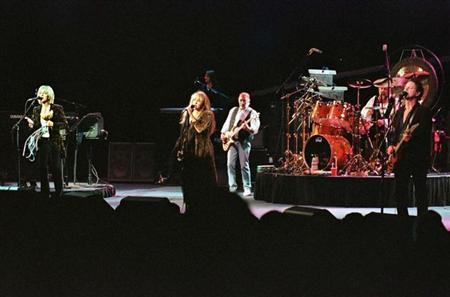 The five original members of the band Fleetwood Mac, (L-R) Christine McVie, Stevie Nicks, Mick Fleetwood, John McVie and Lindsey Buckingham reunite for the first official concert of their reunion tour Sep. 19 at Great Woods in Mansfield, Massachusetts. REUTERS/Files