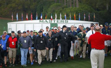 Patrons enter the course to attend the 2014 Masters golf tournament at the Augusta National Golf Club in Augusta, Georgia April 10, 2014. REUTERS/Brian Snyder