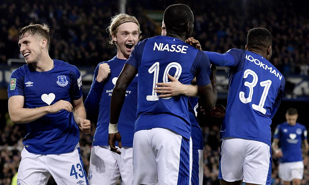 Oumar Niasse celebrates his first Everton goal on Wednesday with Jonjoe Kenny, left, Tom Davies and Ademola Lookman.