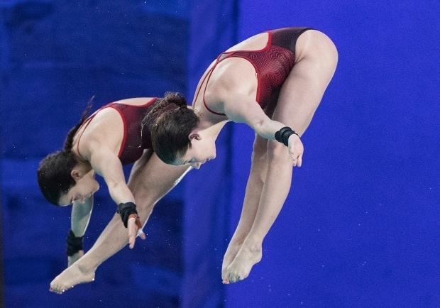 Meaghan Benfeito, left, and Caeli McKay booked an Olympic spot for Canada on Sunday, winning a gold medal in women's 10-metre synchro at a diving World Cup event in Tokyo.  (Graham Hughes/The Canadian Press  - image credit)