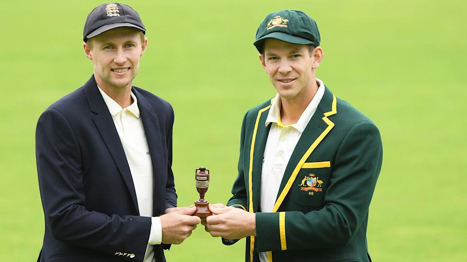 Pictured here, England captain Joe Root and Aussie counterpart Tim Paine pose with the Ashes urn.