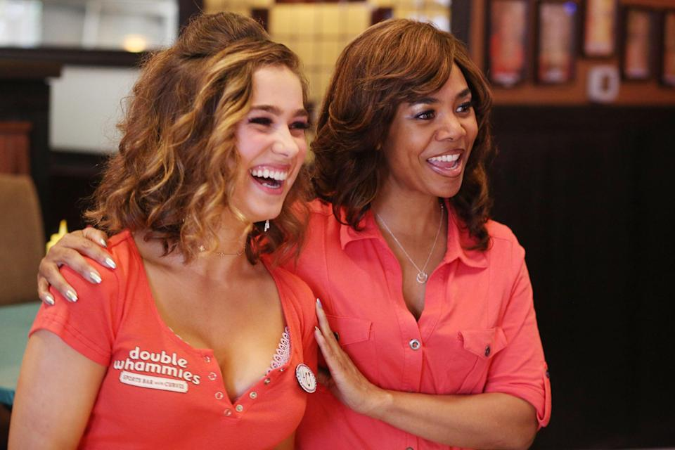 Movie still of Regina Hall and Haley Lu Richardson embracing and smiling