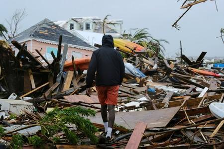 FILE PHOTO: A man walks through the rubble in the aftermath of Hurricane Dorian in Marsh Harbour