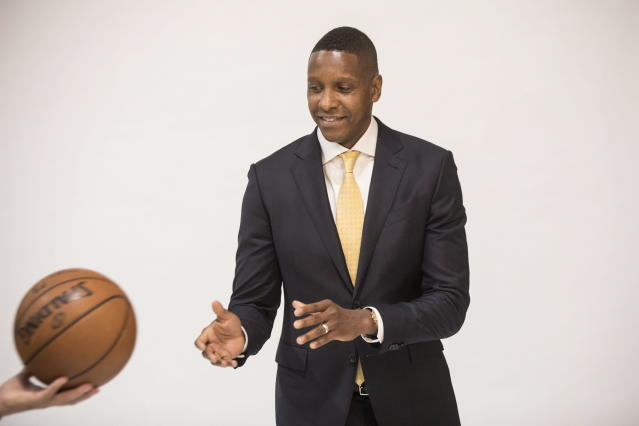 "<a class=""link rapid-noclick-resp"" href=""/nba/teams/tor/"" data-ylk=""slk:Toronto Raptors"">Toronto Raptors</a> president Masai Ujiri is passed a ball for a photo shoot during media day in Toronto on Sept. 25, 2017. (AP)"
