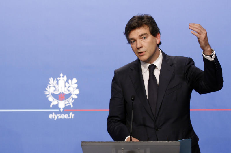Arnaud Montebourg, minister for industrial recovery, gestures during a press conference in Paris, Wednesday, July 25, 2012. The French government has unveiled a plan to prop up the struggling auto industry, which is threatening to eliminate thousands of jobs. Wednesday's plan focuses on making France a center for production of environmentally friendly cars. (AP Photo/Remy de la Mauviniere, Pool)