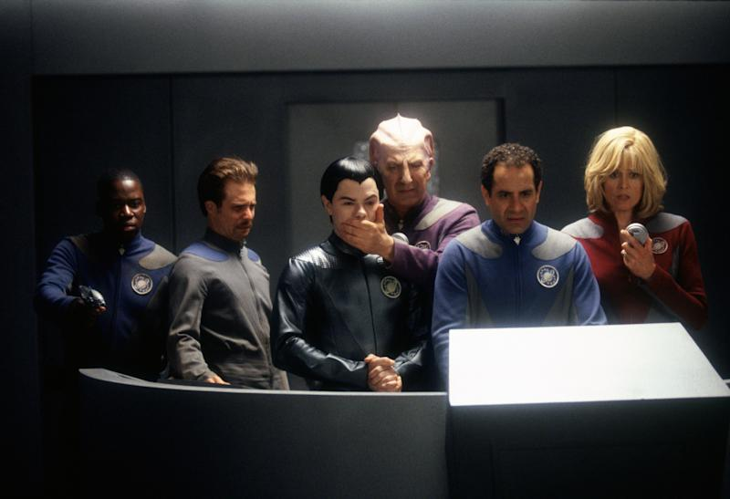 From left to right, actors Daryl Mitchell, Sam Rockwell, Jed Rees, Alan Rickman, Tony Shalhoub and Sigourney Weaver in a scene from the film 'Galaxy Quest', 1999. (Photo by Murray Close/Getty Images)