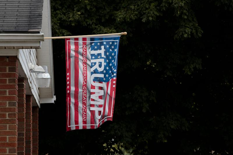 A flag supporting Donald Trump outside a house a block from the Gavin Power Plant in Cheshire, Ohio, on Friday, Sept. 13, 2019.