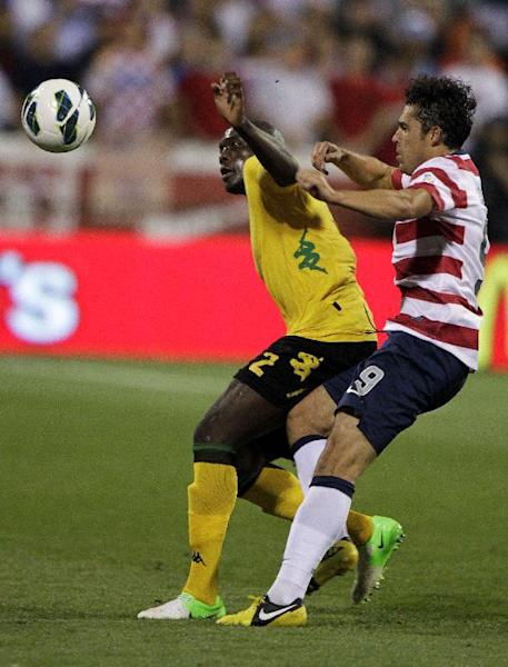 Jamaica's Nyron Nosworthy, left, keeps the ball away from United States' Herculez Gomez during the second half of a World Cup qualifying soccer match, Tuesday, Sept. 11, 2012, in Columbus, Ohio. The United States defeated Jamaica 1-0. (AP Photo/Jay LaPrete)