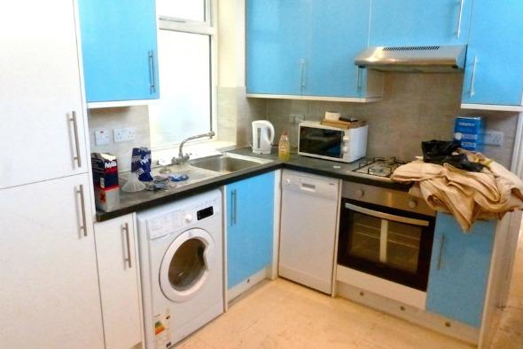 The kitchen of the converted toilet block