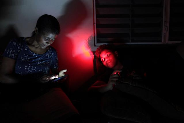 <p>Angie Rodriguez (L) sits with her grandson at their home during a blackout after Hurricane Irma rolled by the U.S. territory's northern coast, in San Juan, Puerto Rico, Sept. 7, 2017. (Photo: Alvin Baez/Reuters) </p>