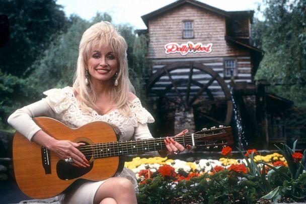 PHOTO: Dolly Parton poses for a portrait with her guitar at Dollywood circa 1993 in Pigeon Forge, Tenn. (Ron Davis/Getty Images)