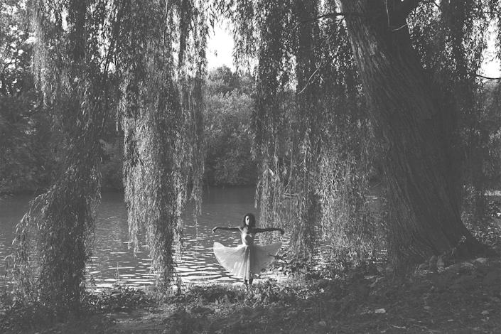 """<p><strong>Grandmother Willow Tree</strong></p> <p>I took this image two summers ago, in 2014. It's a portrait of me with this willow tree in Central Park that I used to go to with my mum and had done since I was a small child. We loved the movie <em>Pocahontas</em>, and this tree we used to call Grandmother Willow Tree because it looked like the tree in the movie. When my grandmother died we put her ashes there, and when my mother died we put her ashes there, too. The tree is almost like a tombstone.</p> <p>This summer I travelled in Europe and when I came back I went to Central Park. I was with my girlfriend and her friends and I said, 'I want to introduce you to my mum, I feel like this is the last physical piece I have of her'. But when I went to see the tree I was shocked to see they had cut it down. I just lost it. I was so upset. I couldn't believe they had cut this tree down. It was my place to mourn my mother and grandmother and it was gone. I fell to the ground and I was crying and it started to rain and I lay there for a moment and everyone gave me some time, and then the sun came out and hit my face and reminded me that you can't hold onto physical things, everything changes and everything evolves. Now the photo is just a memory of a special place for me, a place that doesn't exist any more. </p> <span class=""""copyright"""">Photographs: Courtesy of Kia LaBeija.</span>"""