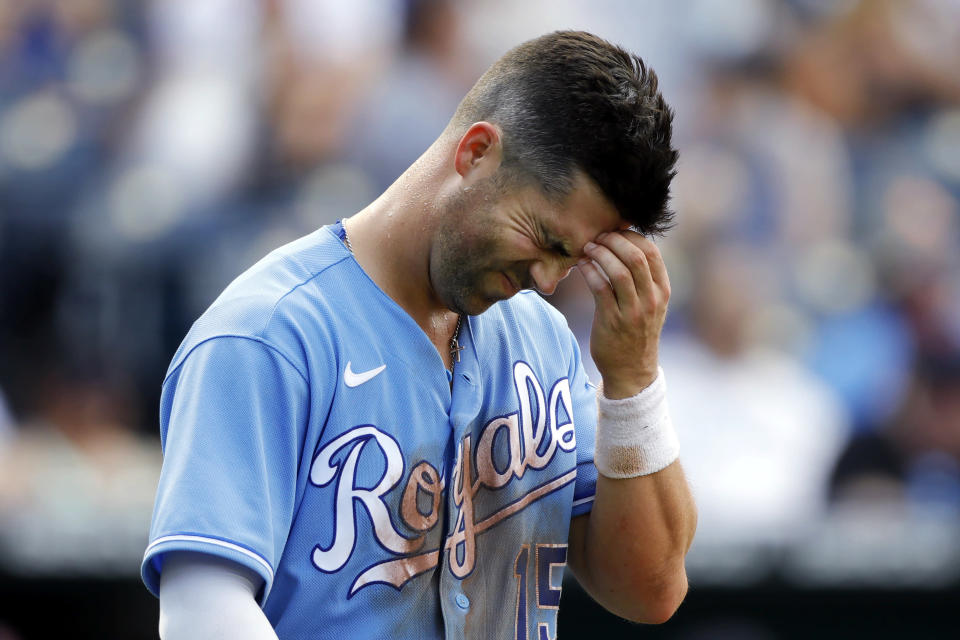 Kansas City Royals' Whit Merrifield reacts after striking out in the seventh inning of the team's baseball game against the Boston Red Sox at Kauffman Stadium in Kansas City, Mo., Saturday, June 19, 2021. (AP Photo/Colin E. Braley)