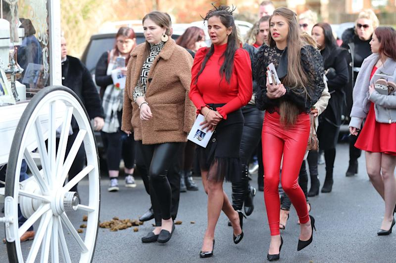Mourners follow the horsedrawn carriages as they leave the St John the Baptist Church (PA)